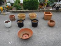 A COLLECTION OF 9 TERACOTA, CLAY,& GLAZED GDN POTS