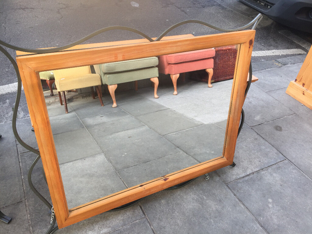 Large Mirror Size 31in x 40in. Can hang both ways . Wooden frame with metal design around frame.