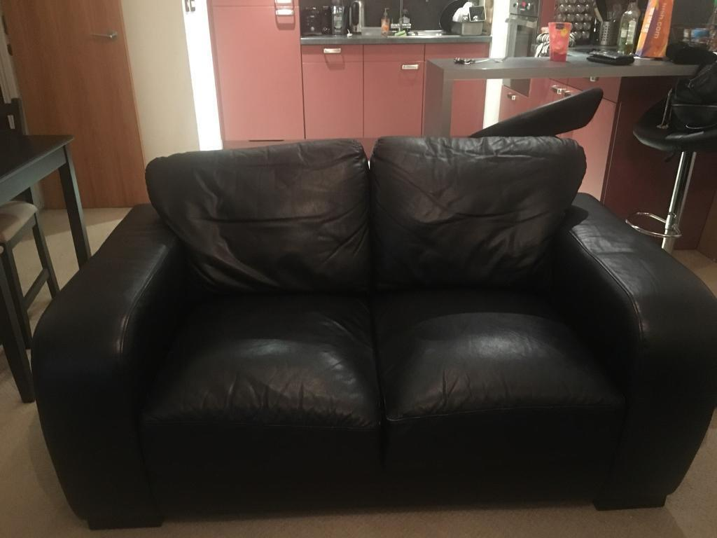 Faux leather black two seater sofa