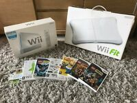 Nintendo Wii package including console, two controllers, wii fit and 7 games