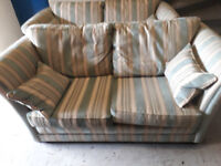 2 light green and cream striped cloth 2 seater sofas