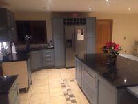 Spray painter .kitchen refurbished