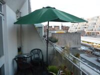 Parasol with base. Reduced price for quick sale.