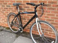 Black hybrid bike in good condition - ready to ride - central Oxford