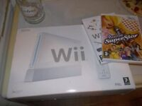 Nintendo Wii console Mint with two remotes all boxedand a couple of games.