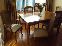 Extendable dining room table with six matching chairs