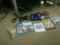 Playstation 3 with 2 controllers and many extras