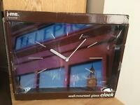 A wall mounted glass clock