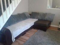 Brown material/leather corner sofa. Free