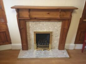 Kinder Gas fire, marble appearance surround and hearth and wood mantle piece