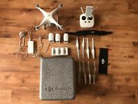 DJI Phantom 4 with 2 extra batteries, charger hub station and lanyard. (PRICE REDUCED)
