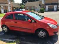 Red Vauxhall Corsa 1L
