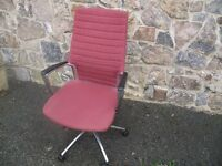 Adjustable, swivel office chair with cloth seat covers.