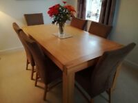 Oak dining table and six chairs by Karel Mintjen in excellent condtion