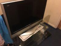 "Panasonic 32"" TV with glass table"