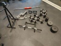 150kg weights, dumbells, barbell, weight plate and A tree