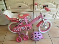 14 Inch Hello Kitty bike with accessories.
