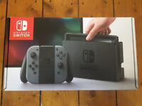 Nintendo Switch (Grey) and ORZRLY Carrying case