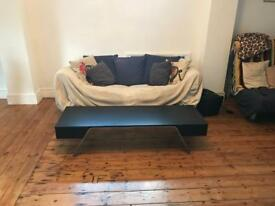 Black Coffee table with storage, slight bit of damage to the end (sofa is free!)