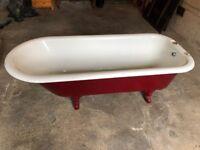 Vintage cast iron roll top bath on feet