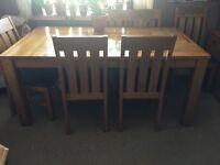 Solid table and 6 chairs for sale!!!
