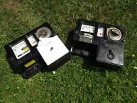 Two vintage coin operated electricity meters for sale - good condition, still working