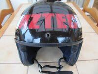 Motor cycle crash helmet.