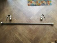 Brass/gold coloured curtain pole with matching curtain tire backs