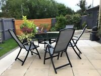 Glass top garden table and six chairs, ex Sterling Furniture. Excellent condition. £180