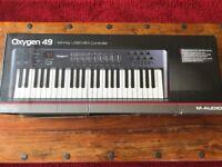 Oxygen 49 - 49 key USB MIDI Controller. Barely used MIDI keyboard, great deal!