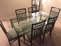 Beautiful tinted bevelled laminated glass top dining table and 6 quality chairs