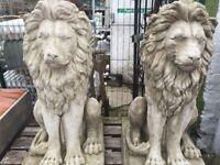 Pair of large Concrete Lions sitting on plinth (90 cm high)