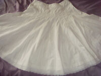 White dropped waist skirt. Hip measurement 32 inches