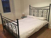 IKEA black bed frame with mattress
