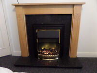 Dimplex opti flame fire with surround and granite inset/harth
