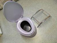 Grey Camping Toilet and BBQ stand