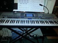 Yamaha 9000 pro keyboard and alloy hard case.