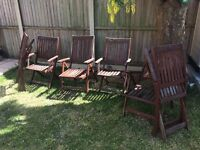 Six wooden garden chairs, including 2 reclining carvers.