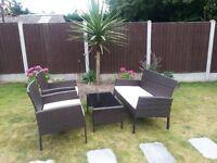 Rattan garden furniture set with cushions