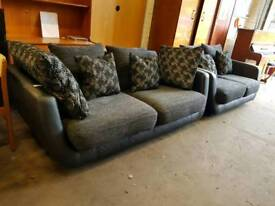 Black leather and fabric three seater and two seater suite