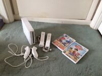 Nintendo wii with remotes and nunchucks