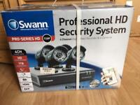 Swann Pro Series CCTV System / setup with 4 720P HD cameras and 1TB storage. Unused in box. can post