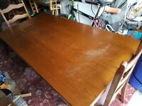 Large oak dining room table with detachable legs and six oak chairs