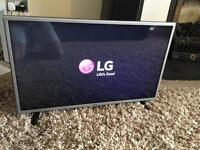 "Brand new LG 32"" tv with stand"