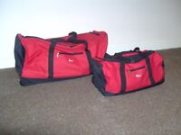 2 Piece Red Wheeled Holdall set with Pull Out Handle. In excellent condition.