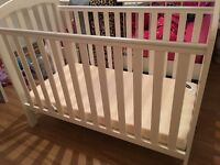 White baby cot with OBaby mattress