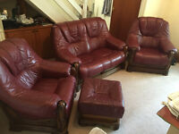 FOUR-PIECE SUITE LEATHER (1 DOUBLE, 2 SINGLE, 1 FOOTSTOOL) FOR SALE - RUSTY RED £300 O.N.O.