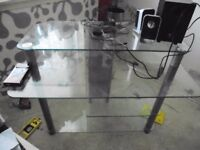 Glass and steel computer desk.