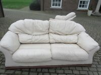 Cream leather sofa three seater and 2 leather chairs. Extremely comfortable.