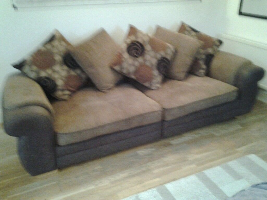 Two Settees one Three Seater and Matching Two Seater Settees with alternate flowers on cushions